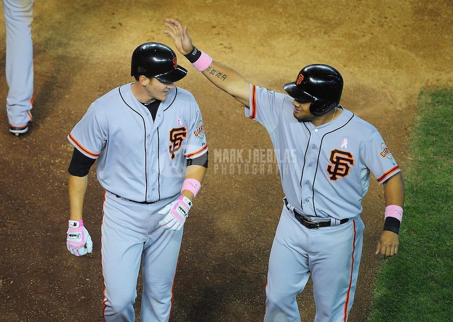 May 13, 2012; Phoenix, AZ, USA; San Francisco Giants batter Brett Pill (left) is congratulated by Melky Cabrera after hitting a two run home run in the fifth inning against the Arizona Diamondbacks at Chase Field. Mandatory Credit: Mark J. Rebilas-