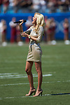 Haley Davis sings the National Anthem prior to the NCAA football game between the South Carolina Gamecocks and the North Carolina State Wolfpack in the Belk College Kickoff at Bank of America Stadium on September 2, 2017 in Charlotte, North Carolina.  The Gamecocks defeated the Wolfpack 35-28.  (Brian Westerholt/Sports On Film)