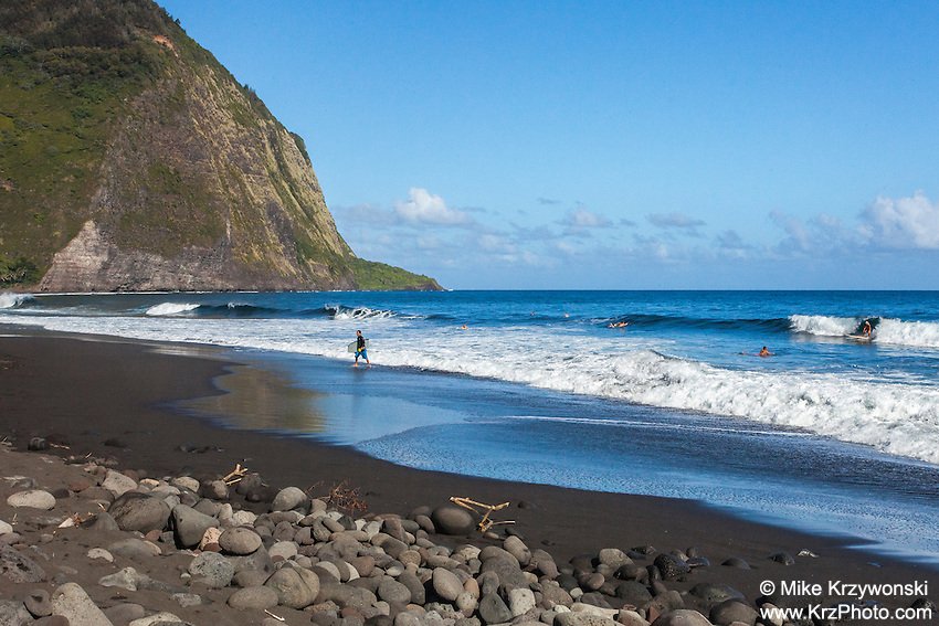 Surfers in the water in Waipio Valley, Big Island, Hawaii