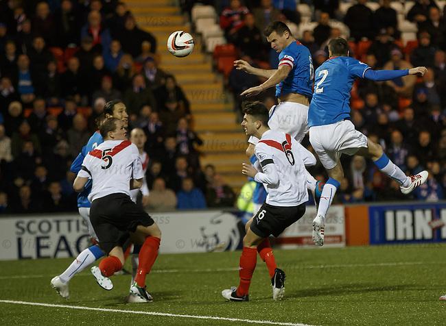 Lee McCulloch sends a header towards goal