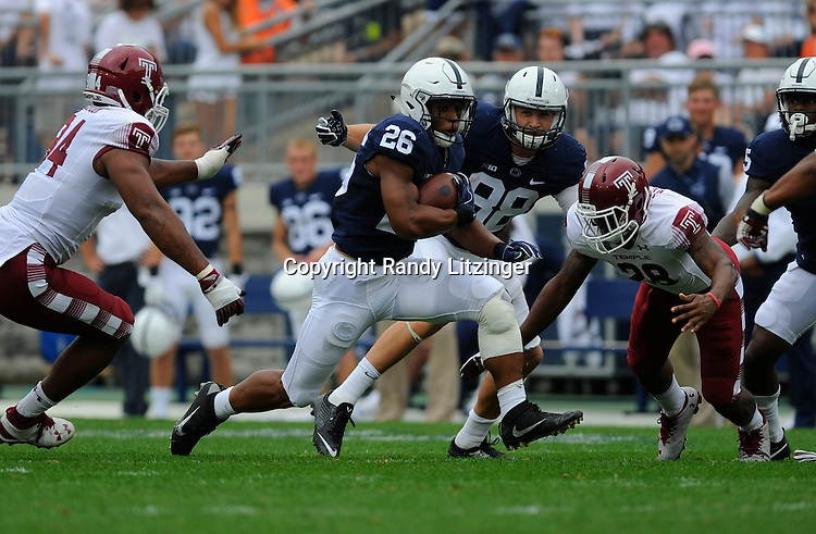 17 September 2016:  Penn State RB Saquon Barkley (26) runs up the middle. The Penn State Nittany Lions defeated the Temple Owls 34-27 at Beaver Stadium in State College, PA. (Photo by Randy Litzinger/Icon Sportswire)