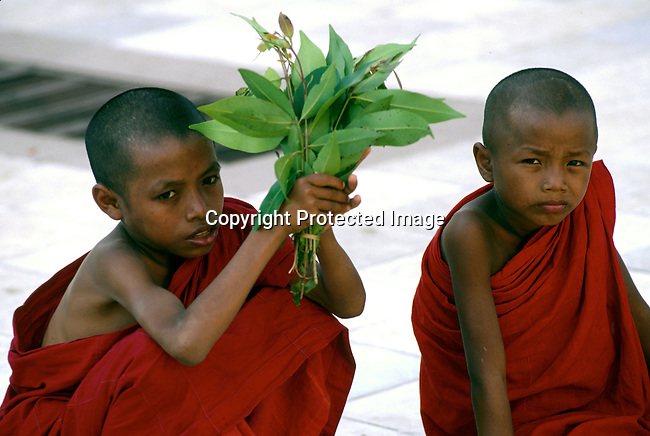Unidentifeid boy monks at a Pagoda on December 23, 1996 in central Rangoon (Yangon) , Burma. They country is ruled by a military government who took power after they annuled democratic elections in 1988..(Photo: Per-Anders Pettersson/ Liaison Agency)