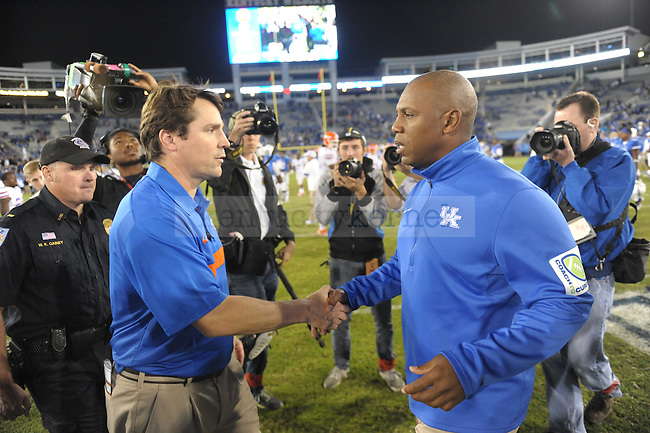 Coaches shake hands after the University of Kentucky football game against Florida at Commonwealth Stadium in Lexington, Ky., on 9/24/11. UK lost the game 10-48. Photo by Mike Weaver | Staff