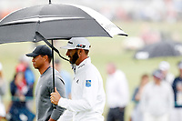Dustin Johnson (USA) walks under an umbrella with Tiger Woods beside him on the 5th hole during the second round of the 118th U.S. Open Championship at Shinnecock Hills Golf Club in Southampton, NY, USA. 15th June 2018.<br /> Picture: Golffile | Brian Spurlock<br /> <br /> <br /> All photo usage must carry mandatory copyright credit (&copy; Golffile | Brian Spurlock)