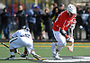 Gerard Arceri #44 of Smithtown East, right, gains possession after taking a faceoff in a non-league varsity boys lacrosse game against Massapequa at Burns Park on Saturday, Mar. 26, 2016. Smithtown East won by a score of 17-16.