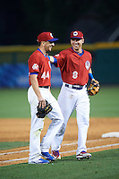 Buffalo Bisons pitcher Pat Venditte (44) and Andy Burns (8) walk to the dugout during a game against the Louisville Bats on June 20, 2016 at Coca-Cola Field in Buffalo, New York.  Louisville defeated Buffalo 4-1.  (Mike Janes/Four Seam Images)
