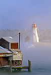Winter view of Mulholland Light on Campobello Island in New Brunswick, Canada seen from Lubec, Maine, USA