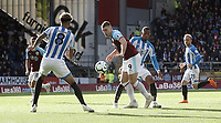 Burnley's Sam Vokes shields the ball from Huddersfield Town's Rajiv van La Parra<br /> <br /> Photographer Rich Linley/CameraSport<br /> <br /> The Premier League - Burnley v Huddersfield Town - Saturday 6th October 2018 - Turf Moor - Burnley<br /> <br /> World Copyright &copy; 2018 CameraSport. All rights reserved. 43 Linden Ave. Countesthorpe. Leicester. England. LE8 5PG - Tel: +44 (0) 116 277 4147 - admin@camerasport.com - www.camerasport.com