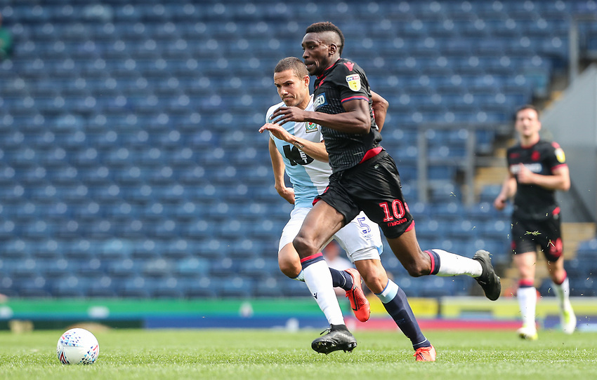Bolton Wanderers' Sammy Ameobi breaks away from Blackburn Rovers' Jack Rodwell <br /> <br /> Photographer Andrew Kearns/CameraSport<br /> <br /> The EFL Sky Bet Championship - Blackburn Rovers v Bolton Wanderers - Monday 22nd April 2019 - Ewood Park - Blackburn<br /> <br /> World Copyright © 2019 CameraSport. All rights reserved. 43 Linden Ave. Countesthorpe. Leicester. England. LE8 5PG - Tel: +44 (0) 116 277 4147 - admin@camerasport.com - www.camerasport.com