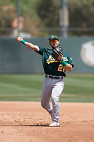 Oakland Athletics second baseman Ryan Gridley (26) makes a throw to first base during an Extended Spring Training game against the San Francisco Giants Orange at the Lew Wolff Training Complex on May 29, 2018 in Mesa, Arizona. (Zachary Lucy/Four Seam Images)