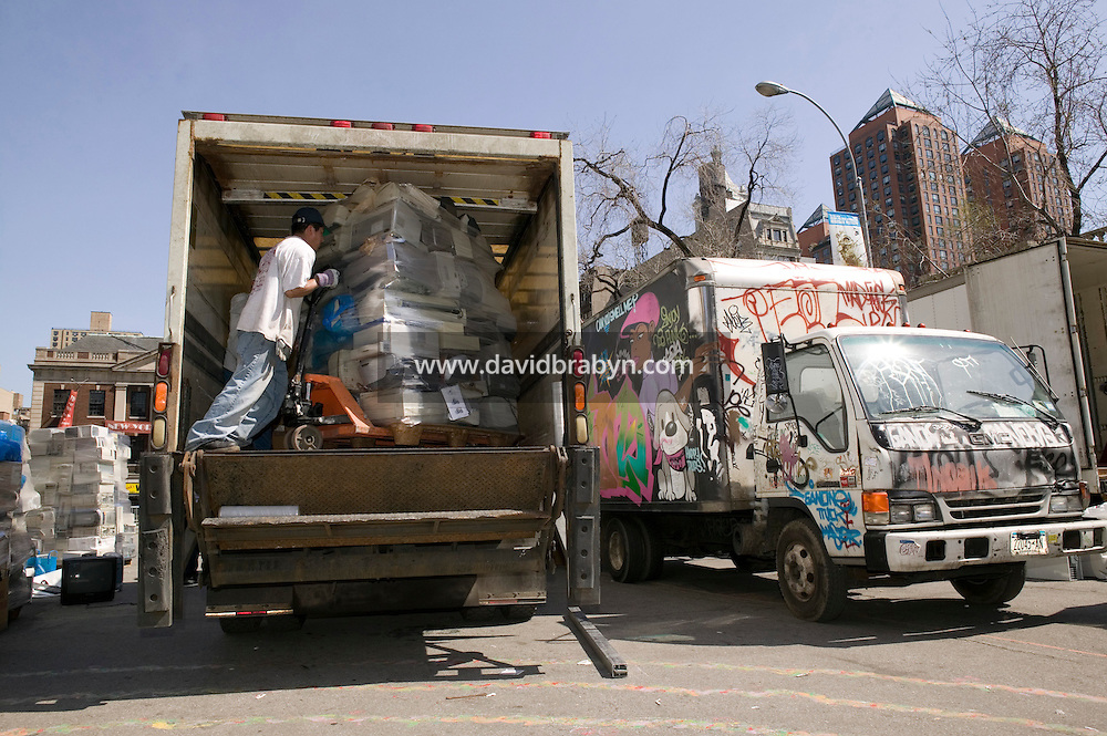 A worker loads a truck with households electronics deposited by new yorkers during a recycling event organized by the New York City Sanitation Department in New York City, USA, 22 April 2007.