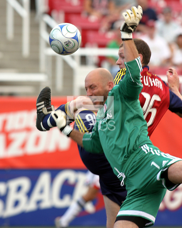 Matt Reis defends the goal against Kenny Deuchar (16) in the 1-2 RSL win at Rice Eccles Stadium in Salt Lake City, Utah on  June 21, 2008.