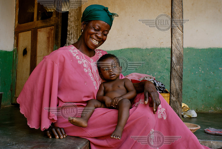 Yaa Tatyia with her grandchild Yaw Eric in the village of Bayerobon 3, Western Ghana....