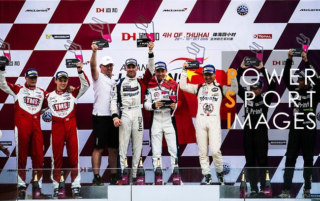Ligier JSP3's drivers David Cheng, Pu Jun Jin and James Winslow of Jackie Chan DC Racing celebrate the victory of LMP3 Class during the 2016-2017 Asian Le Mans Series Round 1 at Zhuhai Circuit on 30 October 2016, Zhuhai, China.  Photo by Marcio Machado / Power Sport Images