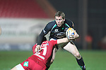 Gareth Davies tackles Gavin Duffy..RaboDirect Pro12.Scarlets v Connacht.02.03.12.©STEVE POPE