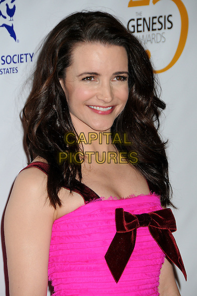 KRISTIN DAVIS .25th Anniversary Genesis Awards held at the Hyatt Regency Century Plaza, Century City, California, USA, .19th March 2011..portrait headshot velvet bow  red  pink smiling beauty .CAP/ADM/BP.©Byron Purvis/AdMedia/Capital Pictures.