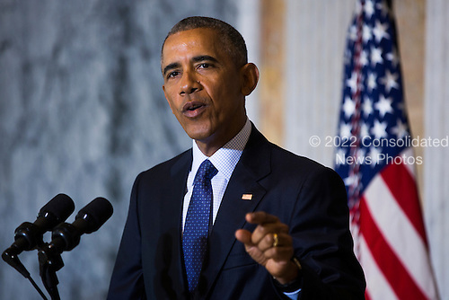 United States President Barack Obama speaks on the Orlando shooting at the Treasury Department after convening with his National Security Council in Washington, DC, USA, 14 June 2016. Obama directly attacked Donald Trump's proposal to ban Muslims from entering the United States<br /> Credit: Jim LoScalzo / Pool via CNP