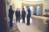United States President George W. Bush meets with Central Intelligence Agency (CIA) Director George Tenet (far left), U.S. Vice President Dick Cheney (center) and National Security Advisor Dr. Condoleezza Rice in the Oval Office of the White house in Washington, D.C. on Sunday, October 7, 2001..Mandatory Credit: Eric Draper - White House via CNP.