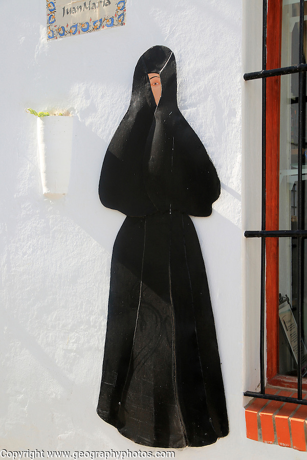Image of traditional clothes worn by women in Vejer de la Frontera, Cadiz province, Spain