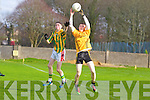 Brion O'Donnell of Listowel Emmets takes the ball ahead of Annascaul's Aidan Fitzgeraldlast Saturday afternoon in Listowel.