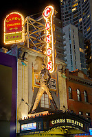 "Low-angle view of the marquee and facade of Canon Theatre, 263 Yonge St, Toronto, Ontario, Canada in July 2007. The statue of Freddie Mercury was erected for the 61-week run of the Queen musical ""We Will Rock You"""