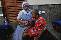 A nun of the Missionaries of Charity at work at Nirmal Hriday - a home for the homeless old people run by the Missionaries of Charity, Kolkata, West Bengal, India. 22nd August 2010. Arindam Mukherjee. Missionaries of Charity was founded by Mother Teresa