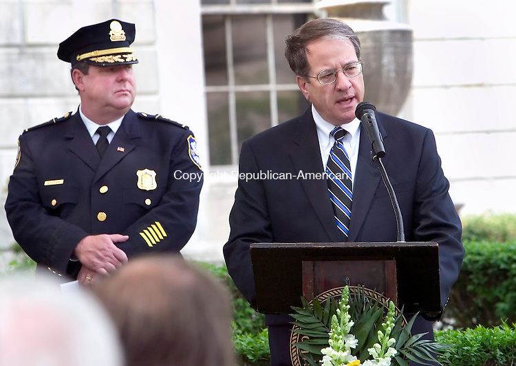 WATERBURY, CT. 16 May 2007-051607SV03--From left, Police Chief Neil O&rsquo;Leary listens to Waterbury State's Attorney John A. Connelly give the keynote speech during the annual police memorial ceremony to honor the 10 Waterbury police officers who have died in the line of duty at city hall in Waterbury Wednesday.<br /> Steven Valenti Republican-American