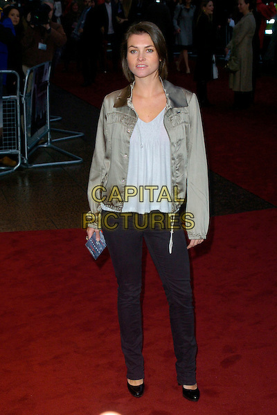 "HOLLY DAVIDSON.Attending the UK Premiere of ""Shooter"",.Odeon West End,London, England,.March 29th 2007..full length gold satin jacket black skinny jeans.CAP/CAN.©Can Nguyen/Capital Pictures"