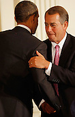United States President Barack Obama (L) embraces U.S. Speaker of the House John Boehner (Republican of Ohio) before delivering remarks during a dinner with bipartisan Congressional leaders in the East Room of the White House, Monday, May 2, 2011 in Washington, DC. Obama and first lady Michelle Obama hosted a group of bipartisan committee chairmen and ranking members and their spouses for the dinner.  .Credit: Chip Somodevilla / Pool via CNP