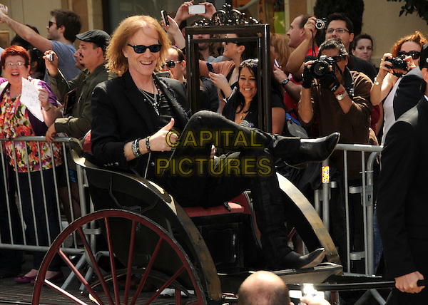 "Tom Hamilton, Aerosmith.Aerosmith ""The Global Warming"" Tour Press Conference held at The Grove, Los Angeles, California, USA..March 28th, 2012.full length black jacket sitting sunglasses shades crowd fans rickshaw .CAP/ADM/BP.©Byron Purvis/AdMedia/Capital Pictures."