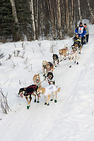 Dodo Perri w/Iditarider on Trail 2005 Iditarod Ceremonial Start near Campbell Airstrip Alaska SC