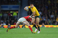 Israel Folau of Australia goes past George North of Wales during Match 35 of the Rugby World Cup 2015 between Australia and Wales - 10/10/2015 - Twickenham Stadium, London<br /> Mandatory Credit: Rob Munro/Stewart Communications