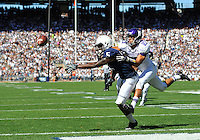27 September 2014:  A halfback pass thrown by Penn State RB Bill Belton (1) goes just out of reach of Penn State WR DaeSean Hamilton (5) in the end zone during the 2nd quarter as Northwestern's Nick VanHoose (23) defends. The Penn State Nittany Lions vs. the Northwestern Wildcats at Beaver Stadium in State College, PA.