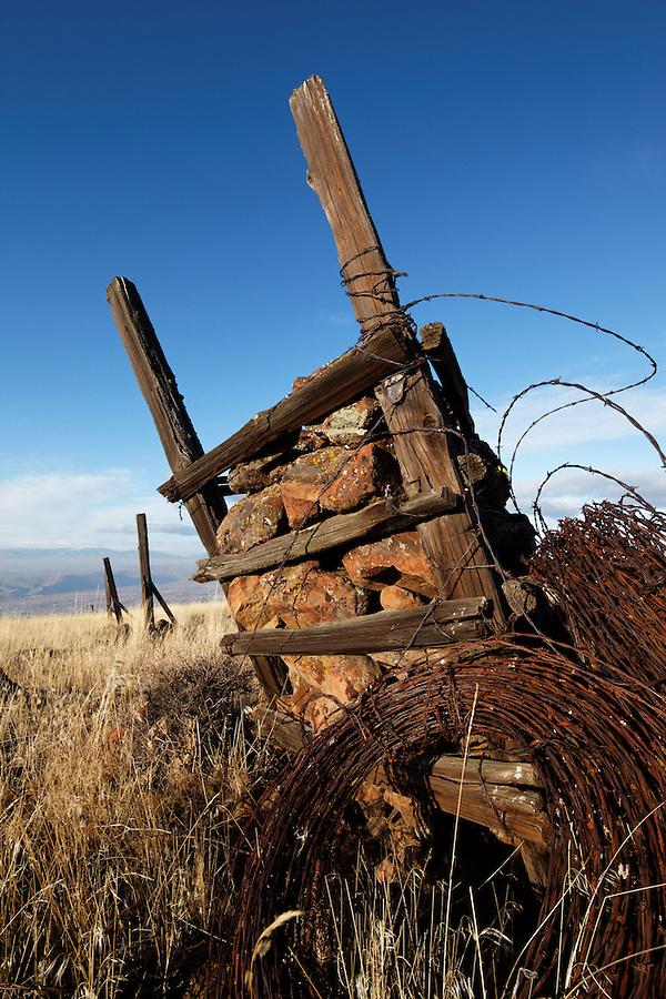Rock jack at corner of barbed wire fence were used to anchor fence corners in rocky terrain, Yakima Rim Skyline Trail, Yakima, Washington, USA