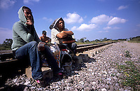 Inmigrants from Central America in Chiapas, Southern Mexico, before boarding a train in their attempt to reach the US border. They are the poorest persons among the inmigrants, they got to Mexico walking from Honduras, Guatemala or Nicaragua. Once in Mexico they can rest in shelters run by catholic priests before facing the dangerous train travel. In this step, they are often abused by police and gangs that steal the men and rape the women.