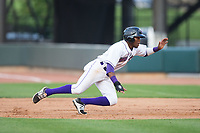 Luis Alexander Basabe (16) of the Winston-Salem Dash dives back towards first base during the game against the Myrtle Beach Pelicans at BB&T Ballpark on May 11, 2017 in Winston-Salem, North Carolina.  The Pelicans defeated the Dash 9-7.  (Brian Westerholt/Four Seam Images)