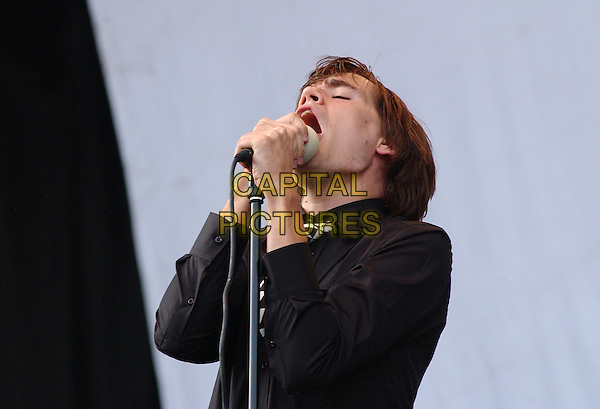 THE HIVES .V Festival 2003, Hylands Park, Chelmsford, Essex, England.17th August 2003  .Ref: Ten.stage, concert, live, music, gig, singing, half length, half-length.www.capitalpictures.com.sales@capitalpictures.com.©Capital Pictures