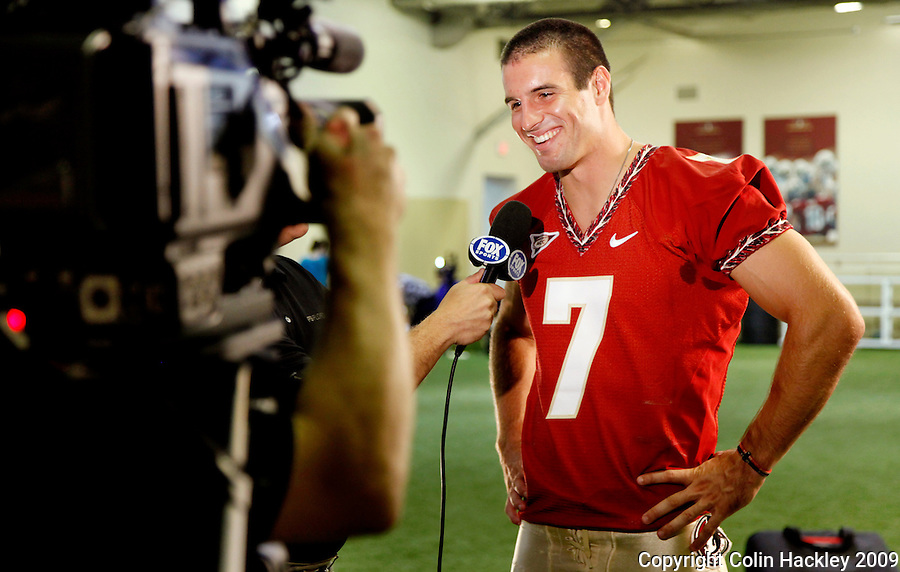 TALLAHASSEE, FL 8/8/10-FSU-080810 CH-Florida State quarterback Christian Ponder talks with a reporter during media day Sunday in Tallahassee. .COLIN HACKLEY PHOTO