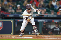 Jake Mangum (15) of the Mississippi State Bulldogs squares to bunt against the Houston Cougars in game six of the 2018 Shriners Hospitals for Children College Classic at Minute Maid Park on March 3, 2018 in Houston, Texas. The Bulldogs defeated the Cougars 3-2 in 12 innings. (Brian Westerholt/Four Seam Images)