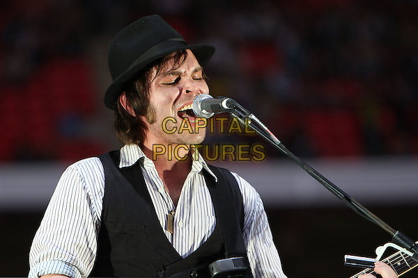 SUPERGRASS.Live at the Wembley Stadium, London, England..June 7th, 2008.stage concert gig performance music black waistcoat hat singing half length.CAP/MAR.© Martin Harris/Capital Pictures.