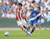Paraguay forward Marcelo Estagarribia (10) goes against Guatemala defender Jonathan Lopez (23) Guatemala tied Paraguay 3-3 in a international friendly match at RFK Stadium, Wednesday August 15, 2012.