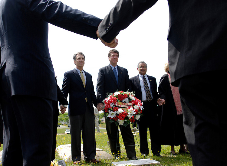 Rep. Thomas Allen, D-Me.; Sen. George Allen, R-Va.; and Rep. Bobby Scott, D-Va., participate in a wreath laying ceremony at the grave of the late Rev. Leslie Francis Griffin of First Baptist, an  outspoken leader for the students of a 1951 African-American student walkout over their school's terrible conditions - which eventually became a lawsuit that was decided as part of the landmark Brown v. Board of Education case. The Congressmen were part of a Faith and Politics Institute delegation to observe how residents of Farmville, Va. are dealing with racial integration; Prince Edward county closed its public schools from 1959 to 1964 instead on integrating them.