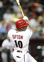 May 30, 2011; Phoenix, AZ, USA; Arizona Diamondbacks batter Justin Upton hits a two run home run in the seventh inning against the Florida Marlins at Chase Field. Mandatory Credit: Mark J. Rebilas-