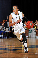 12 January 2012:  FIU guard Phil Taylor (11) drives to the basket in the second half as the Middle Tennessee State University Blue Raiders defeated the FIU Golden Panthers, 70-59, at the U.S. Century Bank Arena in Miami, Florida.