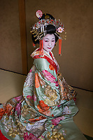 "Japan; Kyoto. Kikugawa, a Tayu or Oiran. Once known as a courtesans, they are highly educated in tea cermony, flower arranging, playing music, calligraphy, are well read and good conversationists. Her black teeth are a sign of beauty. Therare about 5 tayu today, compared to about 300 geisha. ""A tayu is my ideal woman image, I chose to be one. I was also concerned that this culture would disapear."" Model released."