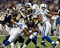 October 25, 2009 - St Louis, Missouri, USA - Rams running back Steven Jackson (39) is tackled by Colts defenders Tyjuan Hagler (56) and Raheem Brock (79) in the game between the St Louis Rams and the Indianapolis Colts at the Edward Jones Dome.  The Colts defeated the Rams 42 to 6.
