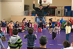 Albany CA Gymnastics instructor leading toddlers in jumping activity during gym program for paretns and chldren