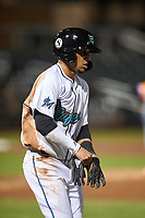 Salt River Rafters Victor Victor Mesa (10), of the Miami Marlins organization, jogs to first base after drawing a walk during an Arizona Fall League game against the Naranjeros de Hermosillo on September 24, 2019 at Salt River Fields at Talking Stick in Phoenix, Arizona. Salt River defeated Hermosillo 4-1. The Naranjeros, of the Mexican Pacific League, played in Scottsdale as part of the Mexican baseball Fiesta. (Zachary Lucy/Four Seam Images)