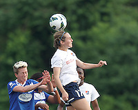 Sky Blue FC midfielder Katy Freels (Frierson) (17) heads the ball.  In a National Women's Soccer League Elite (NWSL) match, Sky Blue FC (white) defeated the Boston Breakers (blue), 3-2, at Dilboy Stadium on June 16, 2013.