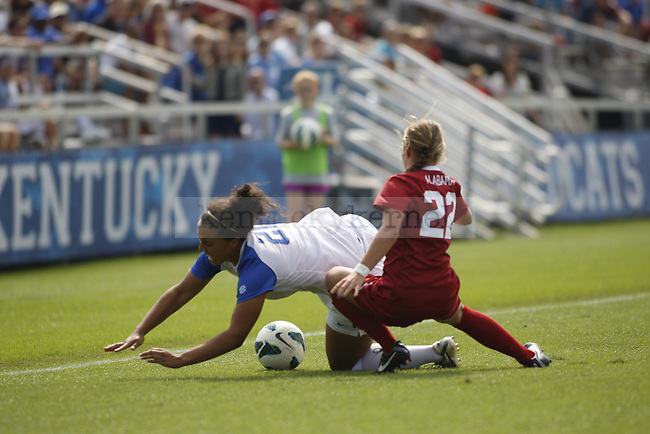UK freshman midfielder Cailin Harris falls while battling Alabama's Kaylee Semelsberger for the ball in the UK women's soccer game against Alabama on Sept. 30, 2012. UK lost 2-1 in overtime. Photo by Becca Clemons | Staff